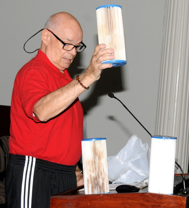 Pictured above is Charles Richardson, resident of El Dorado Mobile Estate Park, holding up one of three dirty water filters at last week's city council meeting, to demonstrate the issue of poor water quality at the park.