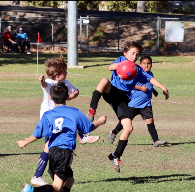 Pictured is a California United 2010 Boys Bronze Alpha player as he takes the ball from his opponent in this past weekend's game. Photos Courtesy Erika Arana.