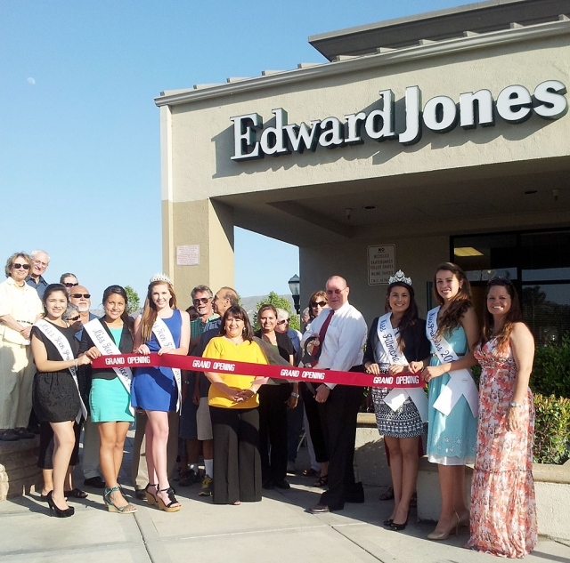 Pictured is the Grand Opening of the new location for Edward Jones, in the Vons Shopping Center complex. The Chamber of Commerce was represented by Ari Larson, Miss Fillmore Samantha Parker and her Princesses, Kyle Wilson, Cindy Jackson and Linda Vazquez.