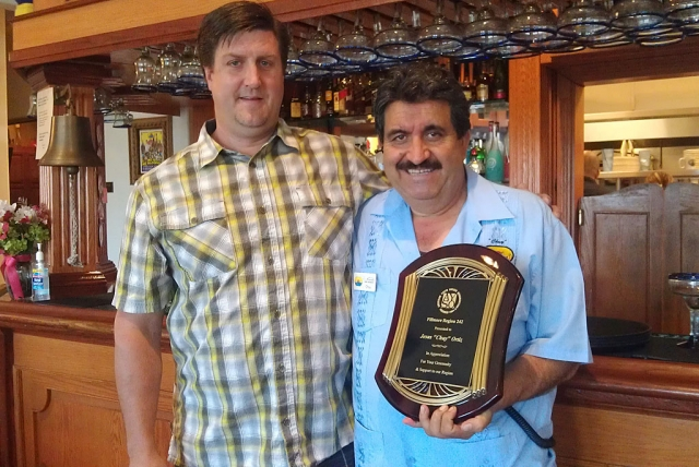 (l-r) Darren Rosten, Region 242 Commissioner, presented this plaque to show his appreciation to Chuy Ortiz, owner of El Pescador, for the support he has given to the local youth soccer organization, AYSO, Region 242. We look forward to his continued support.