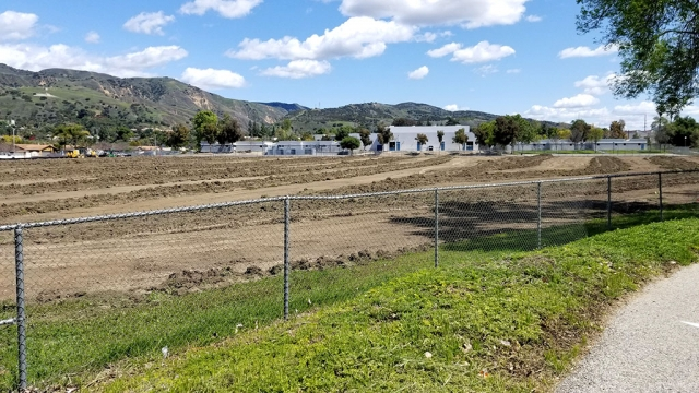 Pictured is the back of Fillmore Middle School where crews have started construction on the improvements to the baseball and soccer fields. Courtesy Fillmore Unified School District.