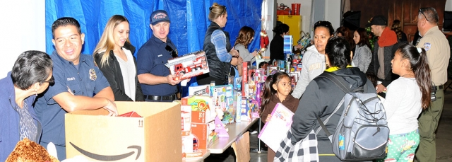 Pictured above a photo from last year's Annual Toy Drive put on by the Fillmore Fire Department. Kids lined up as volunteers helped pass out gifts to each child who attended.