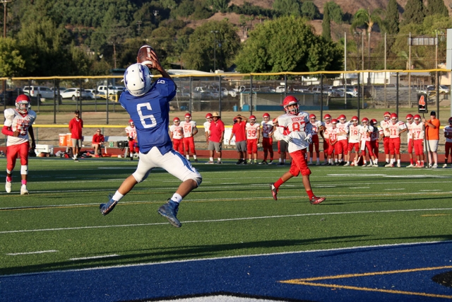 (above) Fillmore Flashes JV #6 leaps into the air to make the touchdown catch and score for the Flashes. The Flashes got back in the win column this week, with their 38-0 win over the Hueneme Vikings on Saturday night. Even with the odd schedule predicated by Edison shutting off power, the Flashes defense stood strong with interceptions by junior DB Ty Wyand and senior linebacker Dylan Crawford. Ty Wyand and sophomore safety Phillip Cervantez also had fumble returns for touchdowns on defense. On offense, senior running back Bryce Nunez ran for 115 yards and a touchdown, while junior receiver Dylan Sierra added 7 catches for 80 yards and a touchdown. Lastly, Flashes JV defeated Hueneme with a final score of 28 to 6. JV will host Nordhoff Thursday, October 17th at 5pm. Next week the Flashes Varsity will be off this week. Their next game is on 11/1 at Santa Paula. Submitted by Coach Sean Miller, photos courtesy Crystal Gurrola.