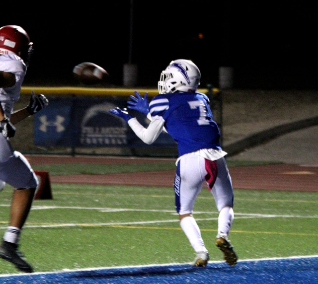 Varsity's #7 Dylan Sierra catching the touchdown pass before a Hueneme player could try and stop him in their