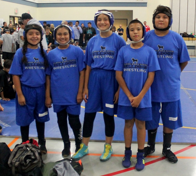 Pictured left to right are Fillmore Middle School Wrestling Team participants Alexa Martinez, Emma Torres, Meya Garcia, Devin Camacho, and Jonathan Patino after the Takedown Tournament. Photo Courtesy Head Coach Michael Torres.Submitted by Head Coach Michael Torres. The Fillmore Middle School Wrestling Team recently competed at Isbell Middle School's Annual Takedown Tournament on Thursday, September 13th. The team was led by 6th graders Jonathan Patino and Emma Torres who were both undefeated with records of 2-0 as each of them compiled 4 takedowns. Meya Garcia (grade 8) was 1-1 with 3 takedowns. Alexa Martinez was 1-1 with 2 takedowns. Devin Camacho (grade 6) was 0-2 with 1 takedown. The team will travel to Fremont Middle School on Wednesday, September 19th for a 4 team dual tournament.