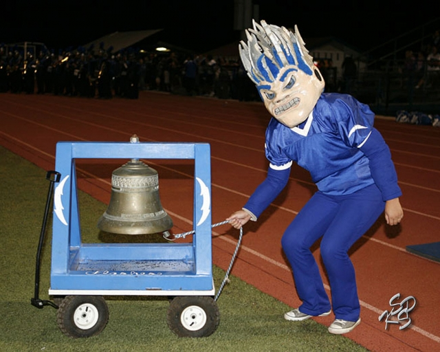 FHS Flashman rings the bell after the Flashes scored a touchdown. Courtesy KSSP Photographic Studio.