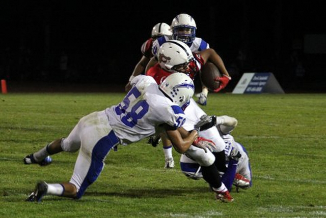 Jeremy Martinez #58 tackles Carpinterias runner during last Friday's game. Martinez has 44 tackles along with 18 solo tackles.