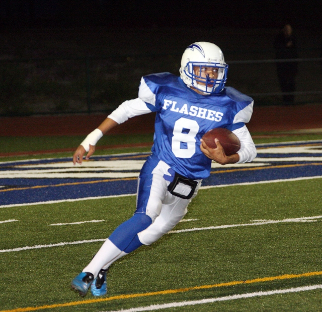 Ernesto Ballesteros #8 gained yardage for Fillmore against Nordoff.