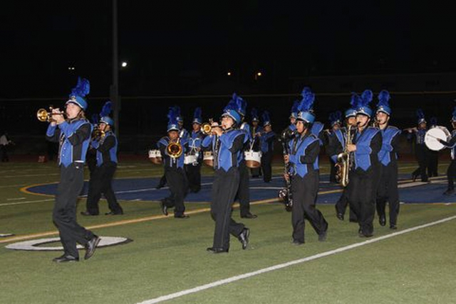 Fillmore High School's band performed during half-time for the crowd.