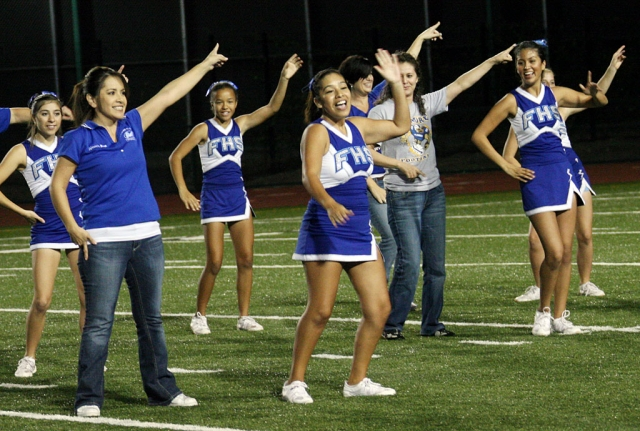 During Friday night's football game the cheerleaders and their moms performed during half-time. Way