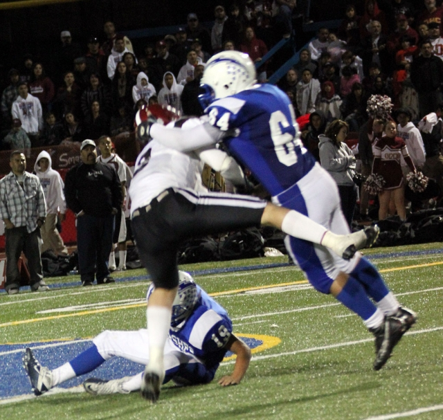 Brandon Pina #64 and Daniel Cruz #19 brought down Santa Paula's runningback.