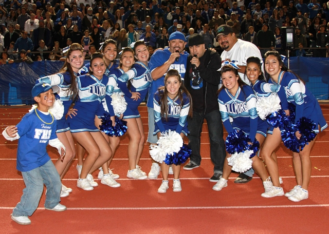 Fillmore High School Cheerleaders are pictured with Rico, Mambo and Chucho from Q104.7. Rico, who is from Fillmore, and Mambo from Santa Paula entertained the crowd during half-time.