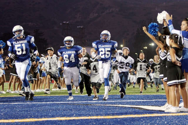 "Fillmore Flashes held Raider Night at last Friday night's game. The little guys were able to run out on the field with the varsity players, and the Raider Cheerleaders were on the field as well. Varsity Football Re-cap: Nathan Ibarra passed for over 150 yds and rushed for 66yds to lead the flashes past Village Christian. Christian Prado was the leading tackler with 10 tackles. ""This is what the team needed more than anything, to believe that they have the ability to execute and end the game with a big win"", according to Coach Dollar. (All photos courtesy Mike Watson)"