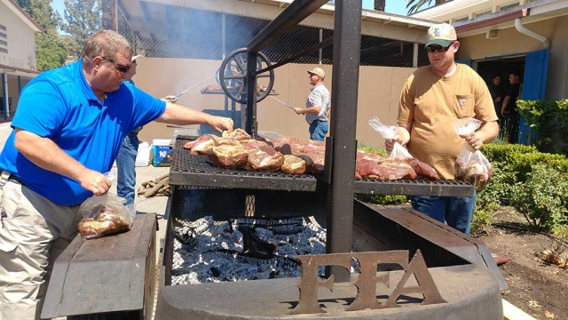 Fillmore's FFA hosted a Tri-tip Barbecue Fundraiser for Fillmore High School's Football Team. Pictured above are Dave Wareham and Andrew Klittich getting the tri-tip on the grill. They barbecued about 190 pieces of tri-tip. Photo Courtesy Sebastian Ramirez.