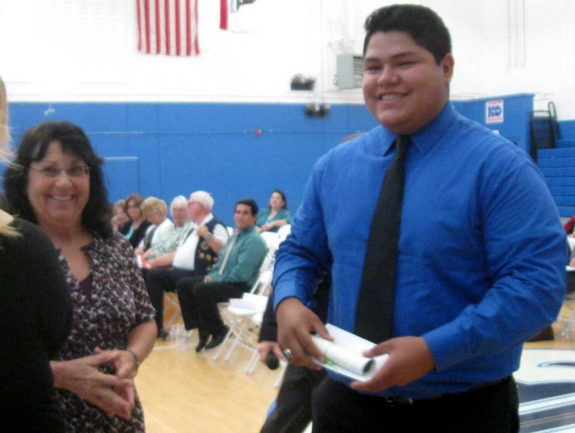 The Fillmore Women's Service Club presented three Community Scholarships this June. At the Fillmore High School Awards night Mimi Burns presented Rafael Reglado a scholarship on behalf of the members. Rafael plans to get a degree in Business and eventually open his own business.