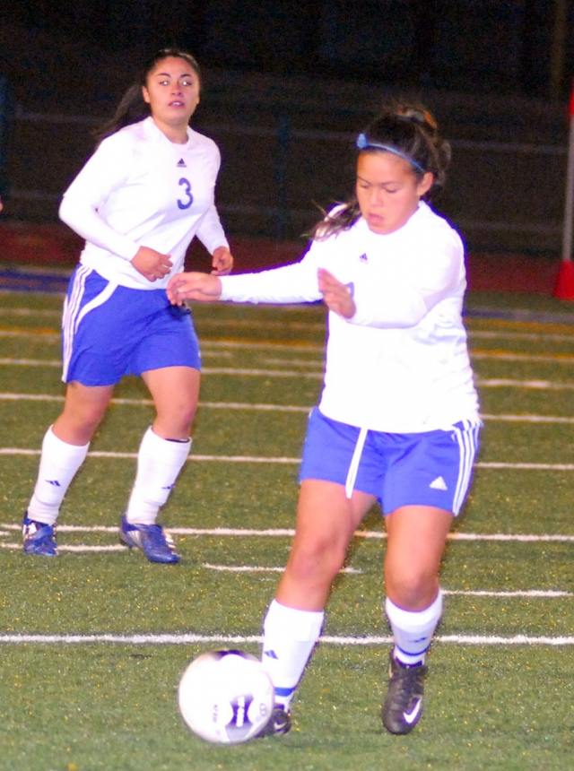 Jasmine Medina show great control against Oak Parks defense. Also pictured Maria Juarez #3.