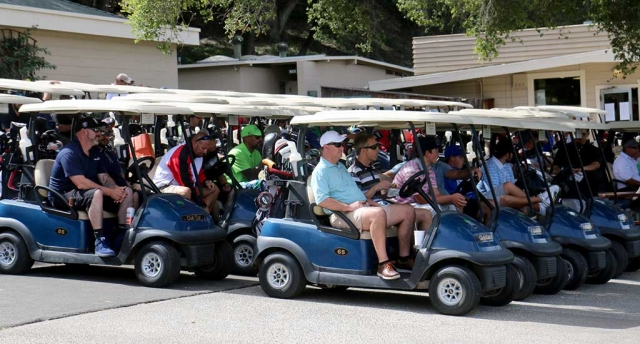 Golfers sit in their carts waiting to get on the green for the 3rd Annual Chief Rigo Landeros Memorial Golf Tournament.