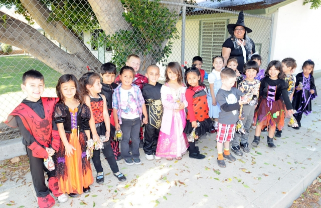 Ms. Vasquez and her kindergarden class walked to Santa Barbara Bank & Trust for treats on Halloween day. On their way back they stopped by the Fillmore Gazette for a photo.