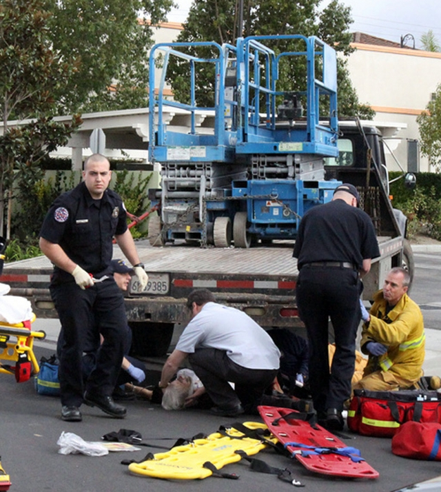 Paramedics treat Helen Shannon 86, after she was struck by a truck moving in reverse.