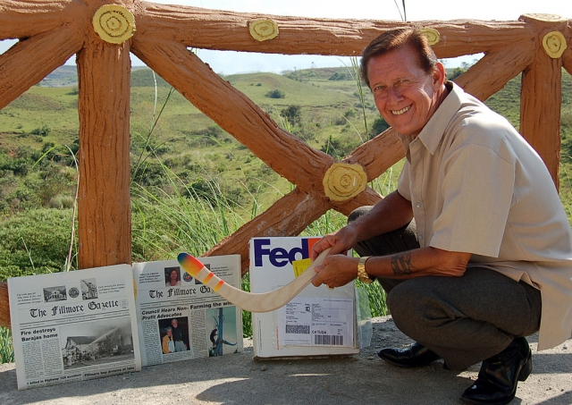 John King (screen names Centurion and Oceans11) in the Philippines with 2 recent editions of The Fillmore Gazette and a hand made boomerang from Fillmore's previous mayor and current City Council Member Steve Conaway.