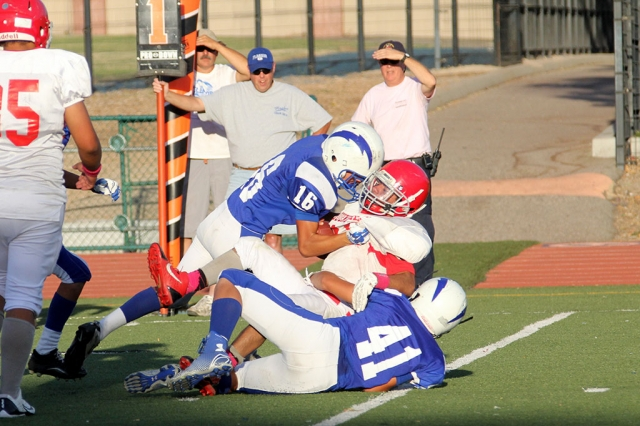J.V #16 Saul Santa Rosa and # 41 Cameron Holmes make a tackle. Photos courtesy Crystal Gurrola.