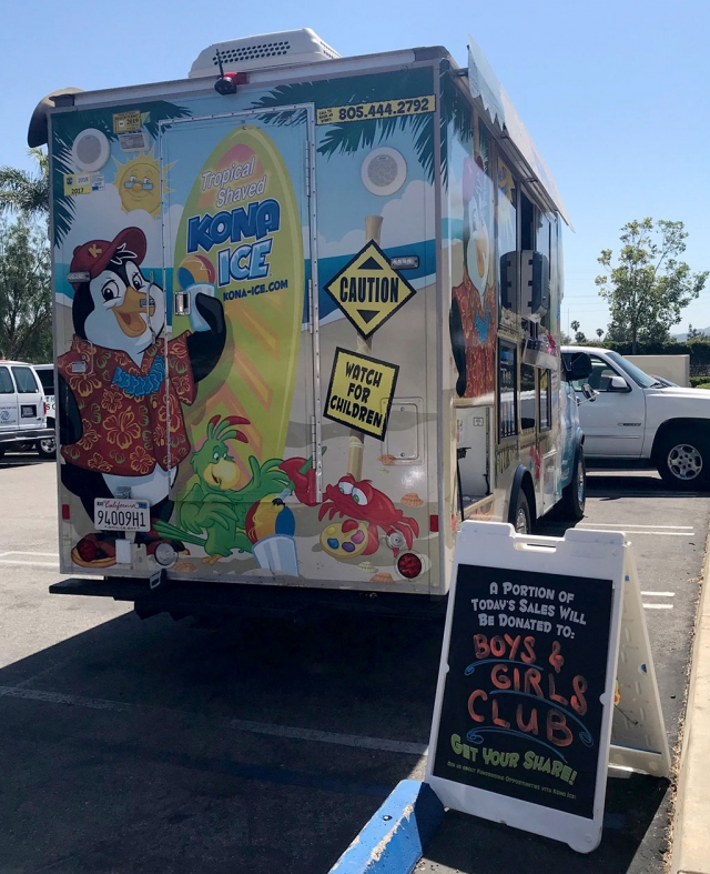 The Kona Ice truck was parked outside the Fillmore Community Pool Tuesday afternoon. The company donated a portion of their sales to the Boys & Girls Club. They also announced that they will be coming back for Rec Swim held Saturdays 9:45pm – 3:15pm and Family Night, Fridays at 6pm – 8pm. Photo courtesy Katrionna Furness.