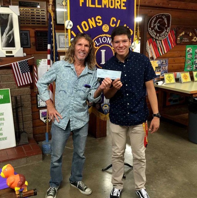 Fillmore Lion Paul Benavidez (left) presents a check for $500 to Leo Club Vice President Jaime Malagon, a senior at Fillmore High School. The Fillmore Lions Club sponsored the new club for young people, which was chartered in 2014. The Lions Club donates money each year to support the Leos. Lions clubs sponsor approximately 5,800 Leo clubs in 140 countries. While helping others in their community, Leos develop leadership skills and experience teamwork in action.