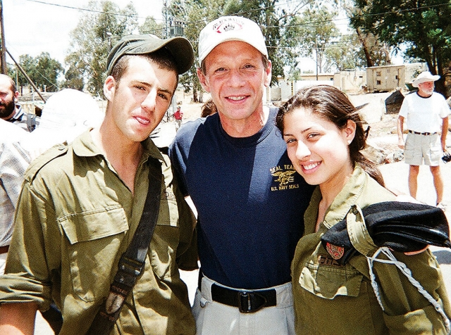 Mark Trimble pictured above (middle) is shown with two Israeli soldiers.