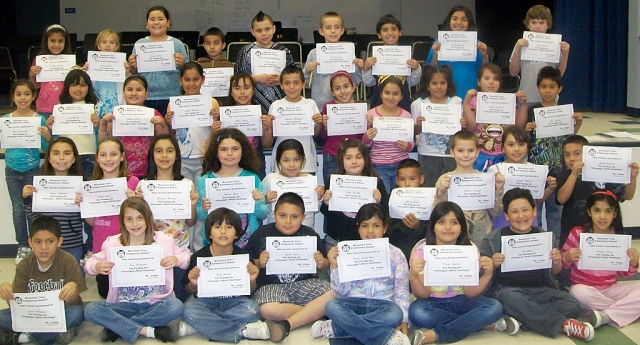 "Pictured above are 39 of the 49 Third grade students who were awarded the Principal's Math Challenge Award. First grade recipients are as follows: Juan Pablo Alfaro, Justice Rodruguez, Elizabeth Rohrer, Sydney Beckett. Second grade had fifteen out of 31 students awarde. Fourth grade recipients are Luke Myers, Alexandra Maritinez, and Maria Lopez. Andy Arana was the only 5th grader to pass the challenge. In order to increase mastery of math facts and promote school spirit, students at Mountain Vista Elementary School are participating in ""The Principal's Math Challenge"". Students are given four minute timed tests in their classrooms. Timed tests range from thirty subtraction facts in 1st grade to 100 multiplication and division facts in 5th grade. Any student who scores a 100% on their classroom test is eligible to ""challenge the principal"" on a three minute timed test. Students who master the three minute timed test at 100% are awarded a certificate by the principal and are recognized throughout the school. The next challenge is February 26th! GO WILDCATS!!!"