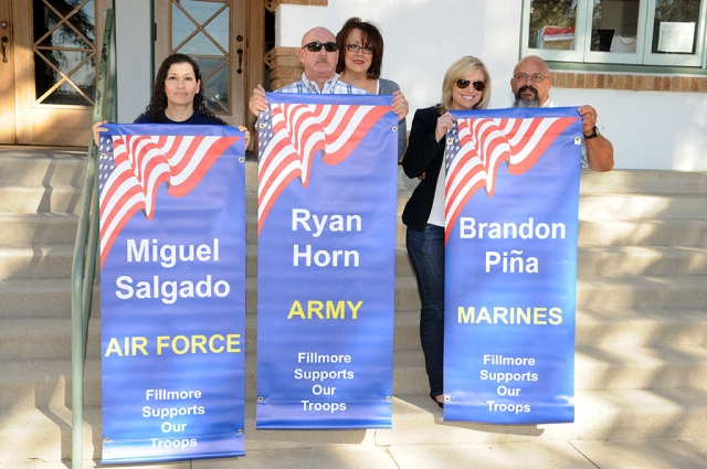 Families of Miguel Salgado (Air Force), Ryan Horn (Army) and Brandon Pina (Marines) display the new banners for service personel from Fillmore. The banners were presented on Wednesday, February 4, 2015.