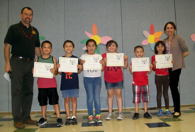 2nd Grade Writers and Readers of the month — Principal Wilber, Jachob Hernandez, Adrian Fuentes, Yuricsi Gallegos, Nayely Guzman, Ethan Ramirez, Jazmine Enamorado, and Board Member Virginia De La Piedra.