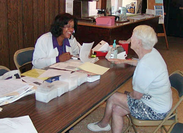 Community Health Nurse Angela Glover, with the VC Health Care Agency, visits the El Dorado Mobile Home Estates once a month to give free healthcare to local seniors. Here she assesses resident Dee Dicey. Included in her mobile services are blood pressure screenings, blood sugar, Health Risk Assessment, BMI Index, Hemo and Cholesterol levels, and bone density checks in the future. Glover is hoping to come into the Fillmore Senior Center soon. She named Braille, weight baring, balance classes, HICAP, Greylaw, Red Cross, and Medicare as just a few agencies and program that could be brought into the center.