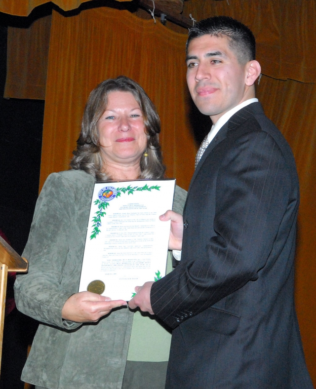 Police Officer of the Year Beau Rodriguez and Mayor Patti Walker.