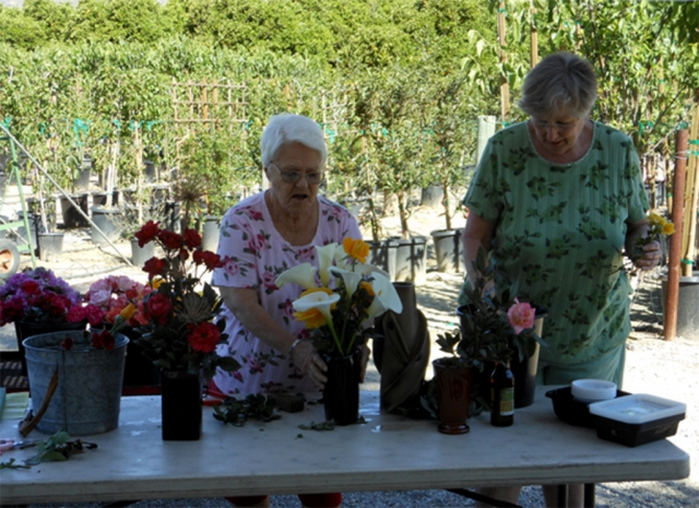 (left) Barbara Schneider and Susan Diller with their demonstration bouquets and arrangements.