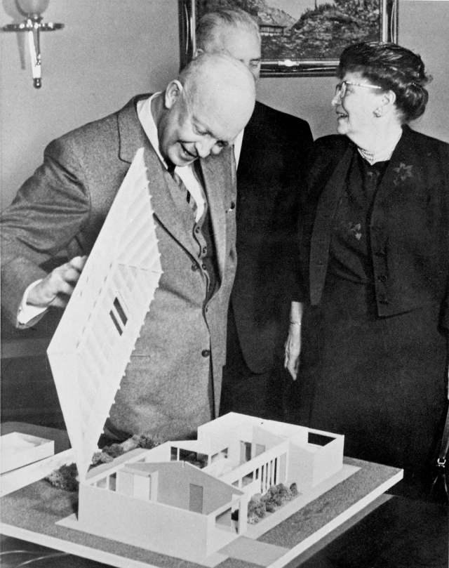 "DR. ETHEL PERCY ANDRUS AND EISENHOWER: Andrus and President Eisenhower looking at ""Freedom House,"" a universal design home that would allow older people to age in place.