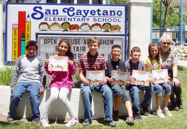 Carol Peterson, seated right, a Forest Ranger and Education Coordinator for the Channel Island National Park came to San Cayetano to speak to the students about what a good citizen is and how displaying good character could enrich the students and others in the community around them.