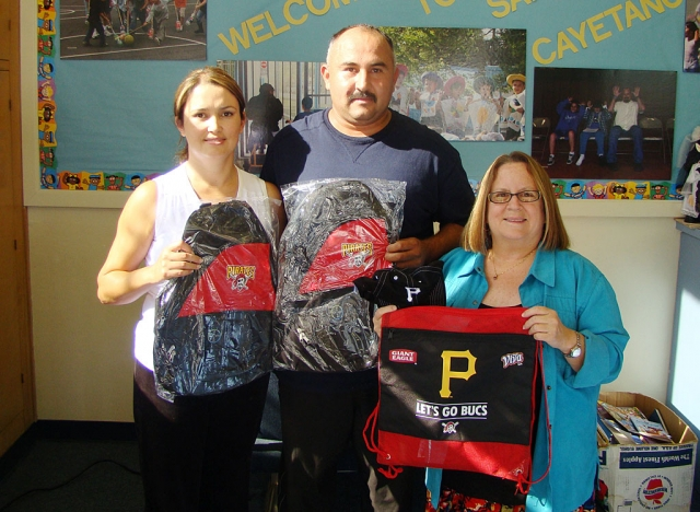 Hector and Maria Quintero are shown with San Cayetano Principal Jan Marholin. Mr. Quintero works with someone affiliated with the Pittsburg Pirates Baseball Team who wished to donate prize incentives to a local elementary school. Students who have good attendance will be able to be in a drawing for Pirates hats, backpacks, sunglasses and much more. The Quintero's son Daniel attended San Cayetano in 5th grade. Actually, Mr. Quintero also attended San Cayetano when he was in grade school. San Cayetano thanks the Quintero Family and the Pittsburg Pirates!