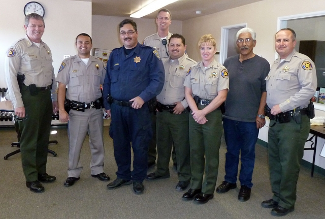 Law enforcement turned out for Tuesday's Police Storefront Christmas. Sheriff Geoff Dean is pictured far left, (r-l) Deputy Leo Vazquez, Community Resource Officer Max Pina, and Fillmore Sheriffs Capt. Monica McGrath, with Fillmore deputies and probation officer.