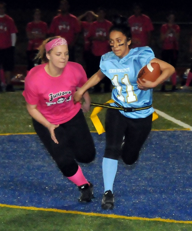 Junior Candice Stines gets ready to pull Leslie Hernandez's flags during the Powder Puff game. Seniors won 12-6.