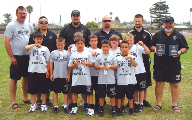 Fillmore Raiders Bantam Division First Place at the Gold Coast Youth Football League 2010 Big Man Competition, and first place at the 2010 Punt, Pass & Kick Competition. Top Row (L-R) Coaches: Robert Ferguson, Nick Herrera, Todd Schieferle, Danny Nunez, Brock Nunez, and Head Coach Greg Nunez. Middle Row (L-R) Brian Arnett, Bryce Nunez, Jake Saviers, Corey Ballard, Garrett Dollar, and Conell Ferguson. Bottom Row (L-R) Ricky Holladay, Jared Schieferle, Nicholas Herrera.