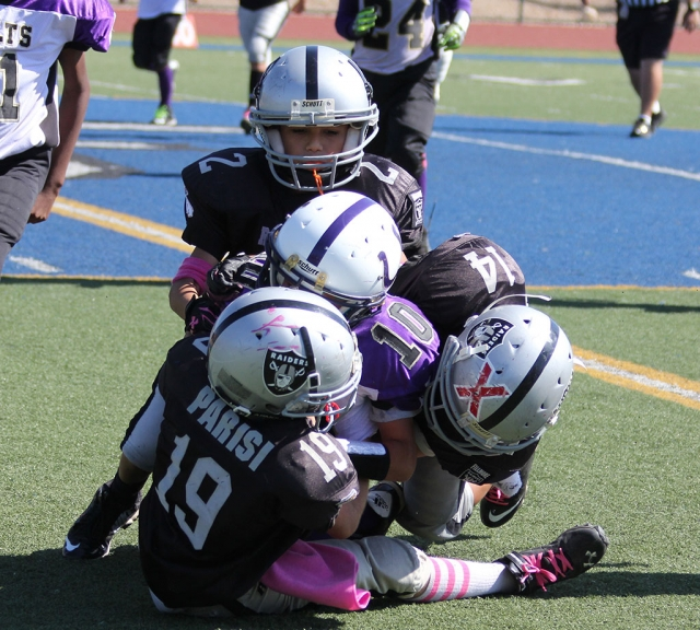 Raiders #19, #14, #2 make a group tackle