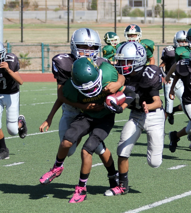 Raiders Junior 1 #2 and #27 make a tackle