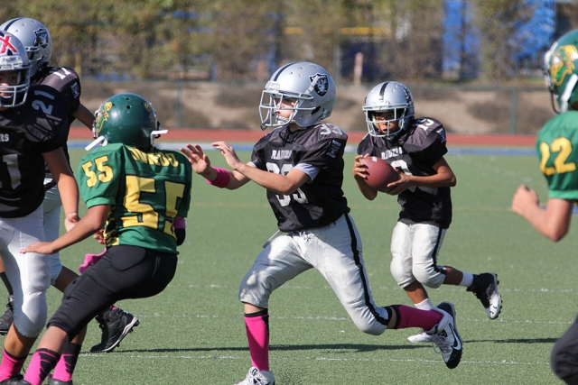 Raiders Junior 1 #33 makes a block for #19