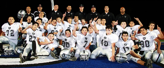 Congratulations to Fillmore's J-2's Raiders football team. The Raiders beat Santa Paula last Saturday 30-14 for the Conference Champs Title. They hold a record of 8-0. They will continue in playoffs this Saturday against Westlake with a home game at 4:00 pm. Pictured above are the J-2 Raiders football players: Vincent Vargas, Ramiro Garcia, Aaron Cronin, Ryan Riberdy, Bakari Cook, Tyler Esquivel, Torey Negrete, Alex Tovar, Adam Jimenez, Deangelo Castro, Brendan Aguilar, Sonny Vigil, Ivan Hurtado, Eddie Cardenas, Michael Castro, Val Pillado, Johnny Chaveste, Steven Chaveste, Sammy Holladay, Nathan Martinez, Ernie Rangel, Joe Gonzalez, and Omar Valdivia. Coaches: Timmy Pillado, David Esquivel, Joseph Aguilar, Vince Vigil, Ram Medina, Cameron