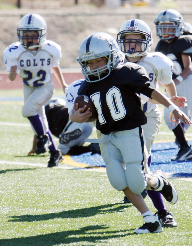 #10 of the Raiders Mighty Might's runs the ball, last Saturday against the Crown Vally Colts. Raiders won 46-20.