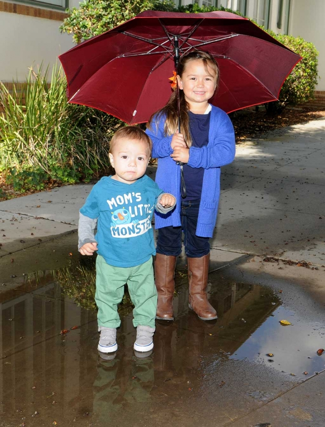 Sara and Jackson Stone enjoy a moment in the rain.