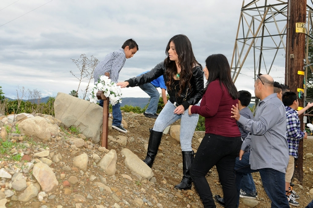 On Sunday, Adrian Moreno's family planted a cross on the Grand Avenue murder site in