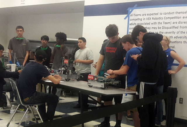 Flashes getting their robot ready to compete.