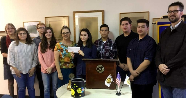 Rotary Club Present Check to the Fillmore High School's Mock Trial Team. FHS students, Mr. Murphy & Laura Bartels receiving a check supporting the FHS Mock Trial Team from club president Julie Latshaw.