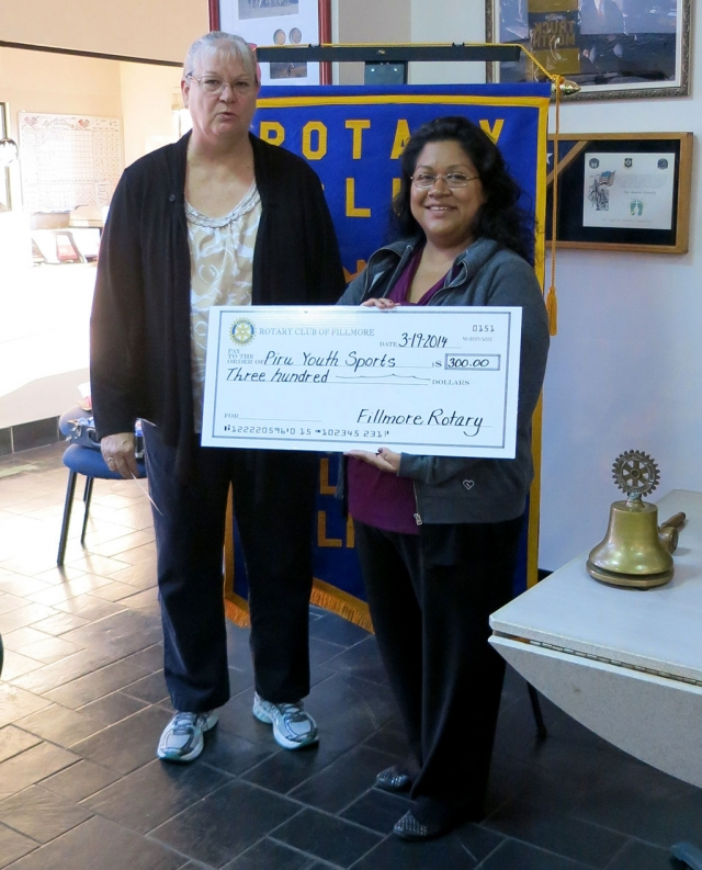 Cindy Blatt, of the Rotary Club of Fillmore, presented Joanne Torres, of Piru Youth Sports, a check for $300. This is the sixth year of youth sports with over 160 students involved in baseball this season.